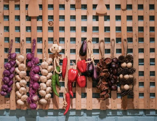 Use a wooden hanging rack to hang vegetables and fruits