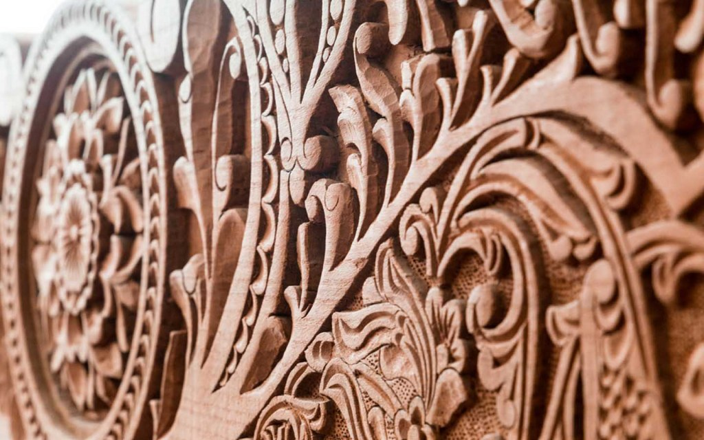 Remove any dust particles from the carved furniture